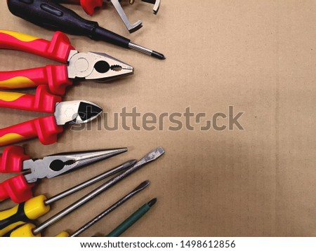 Construction tools, craftsman tool with copy space for text on packing paper background.