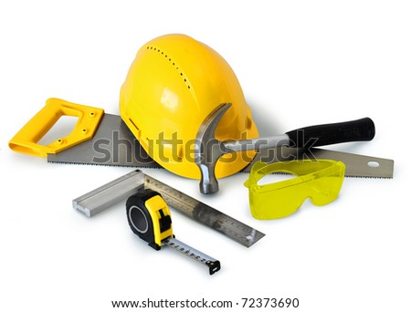 Construction tools gear and safety equipment on white background isolated