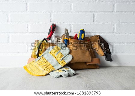 construction tools on the ground and wall Foto stock ©