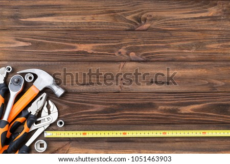 Construction tools on the wooden background. #1051463903