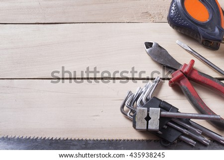 Construction tools on wooden background. Copy space for text. Set of assorted work tools. Top view. #435938245