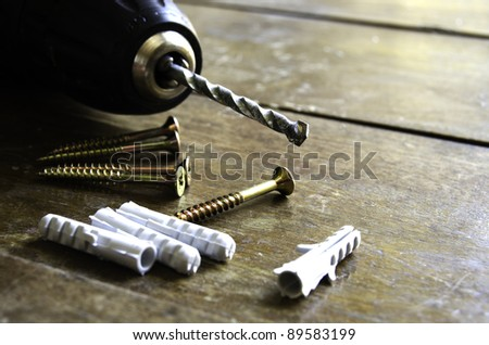 Construction tools over a wooden background