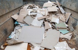 Construction waste and drywall material in one container