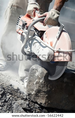 construction work of stone cutting by cut-off saw with diamond wheel