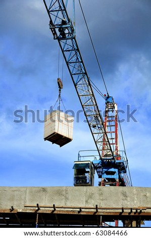 Construction work site  Process : Transfers the weight of a crane