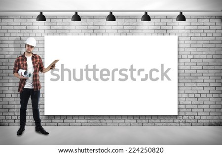construction worker and Blank frame on White Brick wall with Ceiling lamp