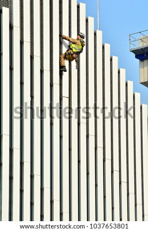 Construction worker and white facade building