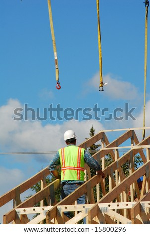 Construction worker and wooden trusses