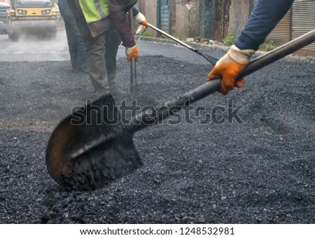 Construction worker. Asphalt Road construction and restoration work