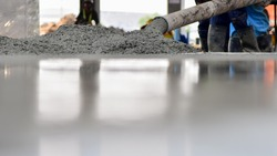 Construction worker Concrete pouring during commercial concreting floors of building in construction site and Civil Engineer