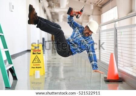Construction worker falling off a ladder inside a building