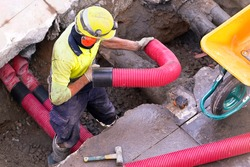 construction worker for restoir and repair pipes for underground electrical wiring conduction