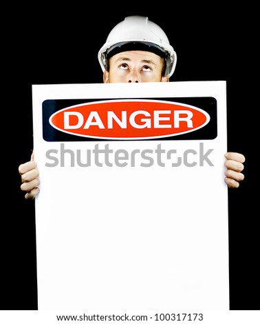 Construction worker in a hardhat holding a blank sign entitled Danger warning of danger from above