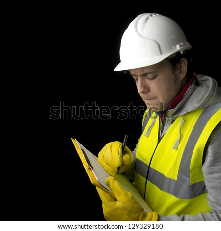 construction worker in helmet, high visability vest and gloves, writing on clipboard