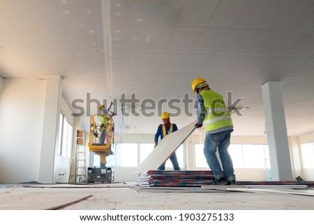Construction worker installation ceiling work