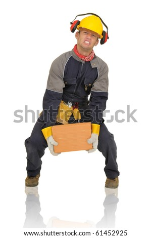 Construction worker lifting a heavy brick isolated in white