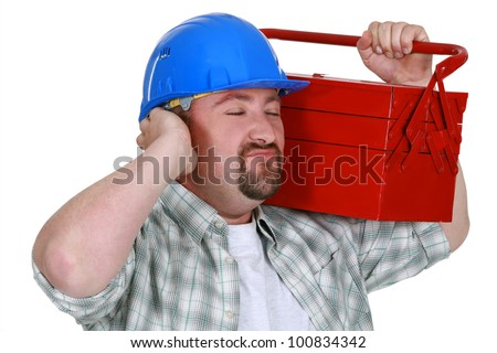 Construction worker listening to the sweet sounds of his toolbox