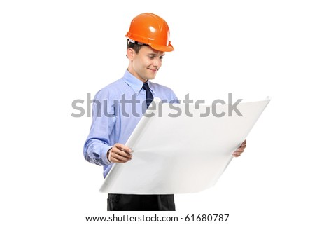 Construction worker looking at blueprints against white background