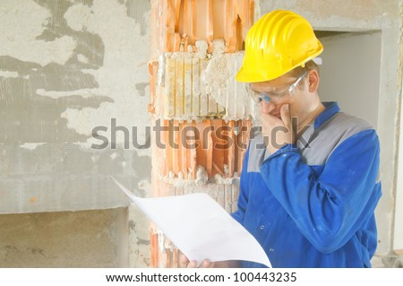 Construction worker looks at the plan