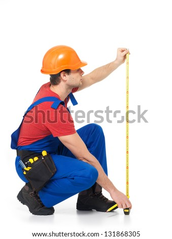 Construction worker measuring the wall over white background -  manual worker images.