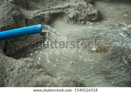 Construction worker mix cement with a mixture of cement, sand, stone and water. #1540526318