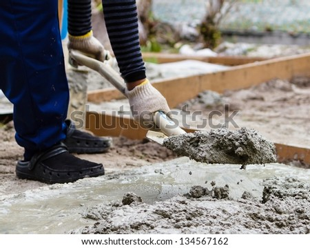 Construction worker mixing cement