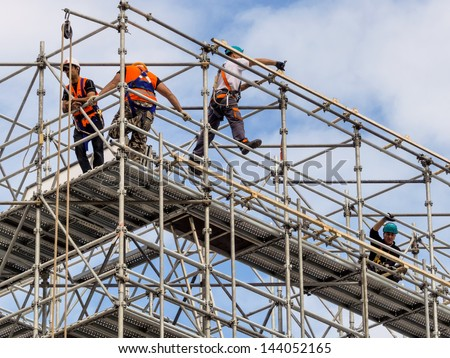 construction worker on a scaffold, symbolfoto for building, construction boom, labor protection Сток-фото ©