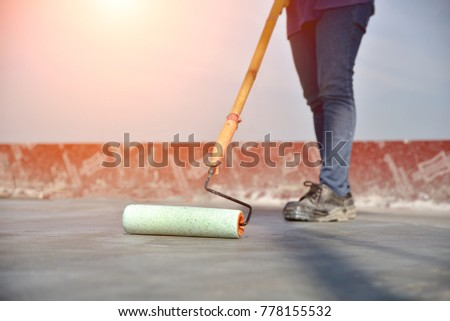 construction worker paint  chemical water proof curing concrete slab