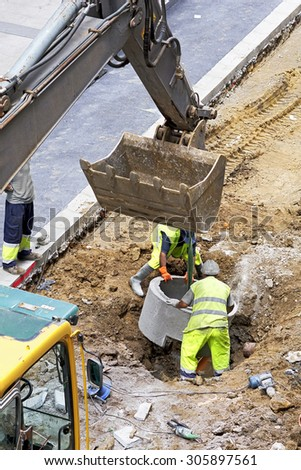 construction worker repairing the sewer and water  pipes in the street city