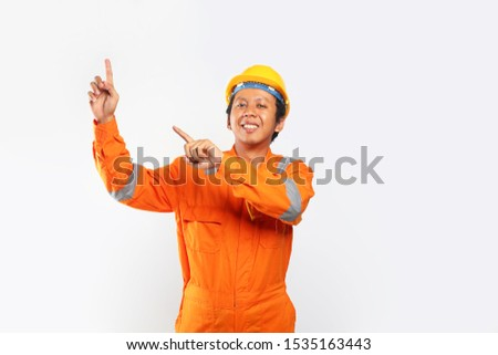 construction worker sign pointing blank space looking up #1535163443
