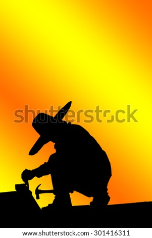 Construction worker silhouette at work.