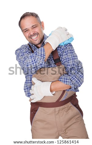 Construction Worker Suffering With Shoulder Pain On White Background