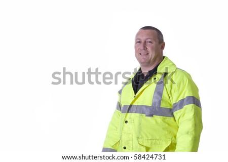 construction worker upper torso profile in fluorescent jacket - stock photo