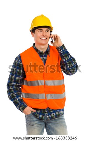 Construction worker using cell phone.Three quarter length studio shot isolated on white.