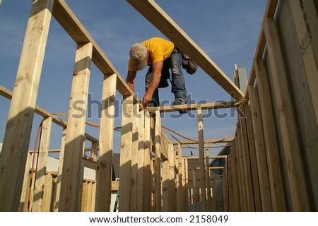 Construction worker using speed square