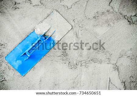 Construction worker wall plastering tools renovating apartment house. Construction finishing works.
