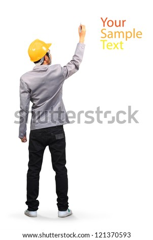 Construction worker wearing a helmet and sketching on whiteboard, ( back view ) isolated on white background With Clipping Paths for design work