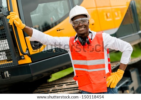 Construction worker with a crane at the background