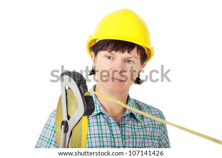 Construction worker with a tape measure - stock photo