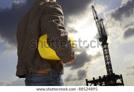 construction worker with building silhouette