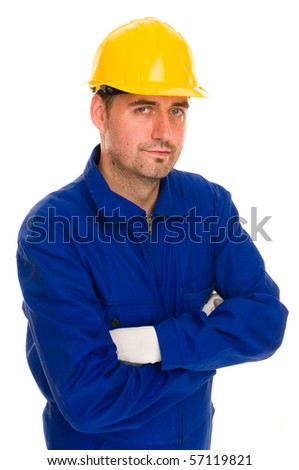 Construction worker with safety suit and gloves with yellow safety hat looks into the camera, isolated on white