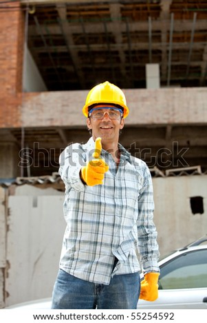 Construction worker with thumbs up at a building site