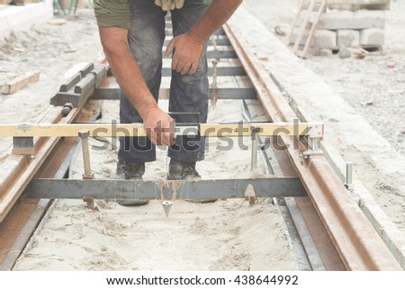 Construction worker working on railway tracks.