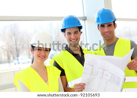 Construction workers looking at building plan