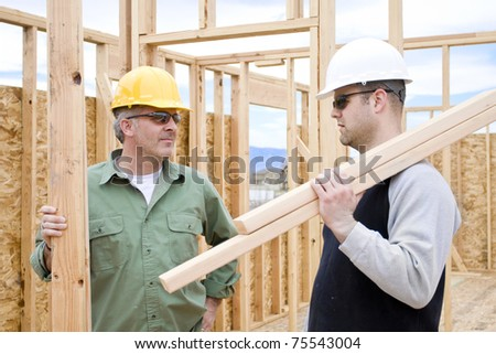 Construction Workers on the job building a home