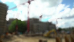 Construction workers site and building of housing at laborer work outdoor which has tower crane blurred sky background with copy sp. Engineer, architecture.