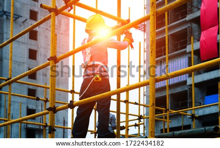 Construction workers working on scaffolding. Сток-фото ©