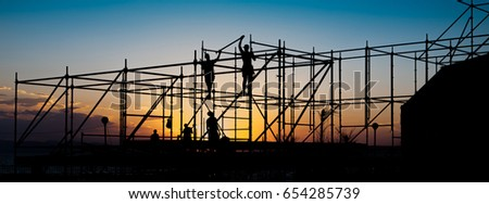 Construction workers working on scaffolding.