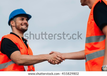 Construction Workershandshaking on Construction site #455829802