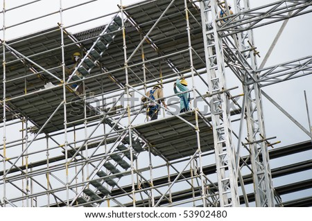 construction workerson a scaffold
